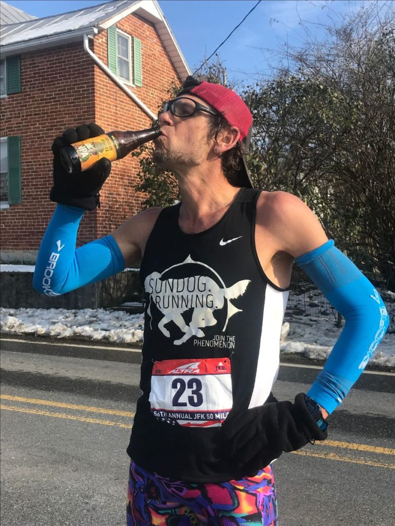 Enjoying a beer at mile 46 before making the final push